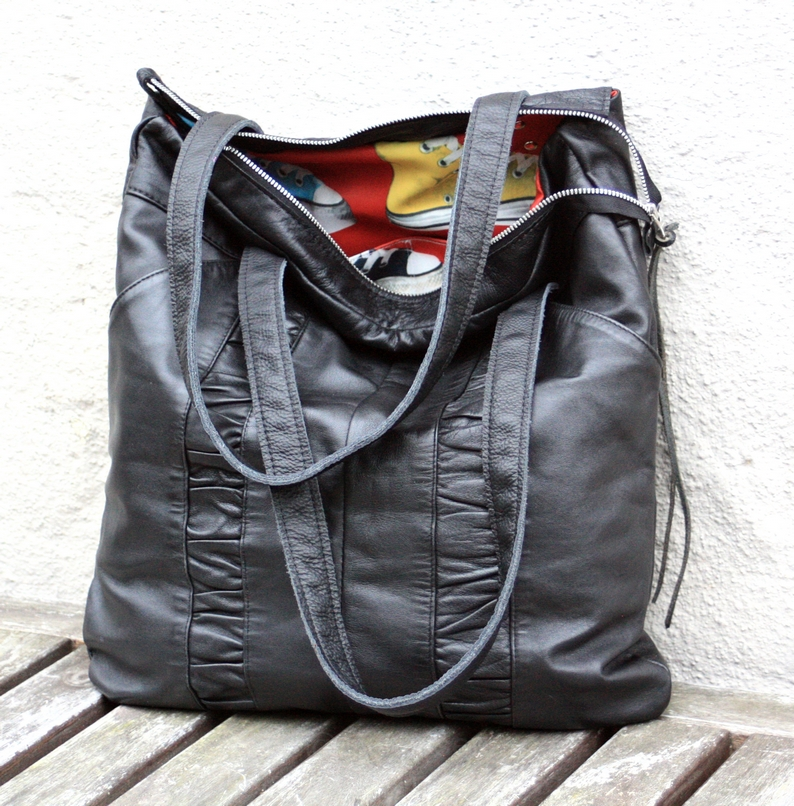 Black leather city bag made of a pair of trousers