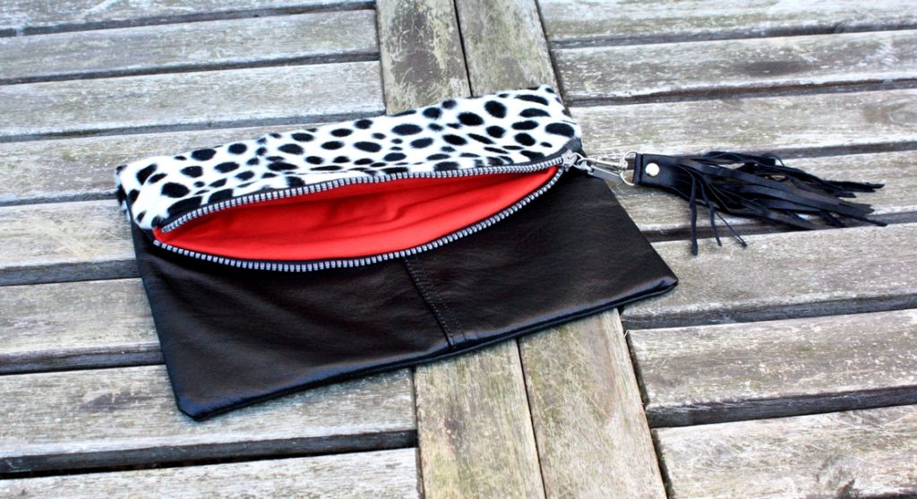 Recycled leather clutch with fake fur