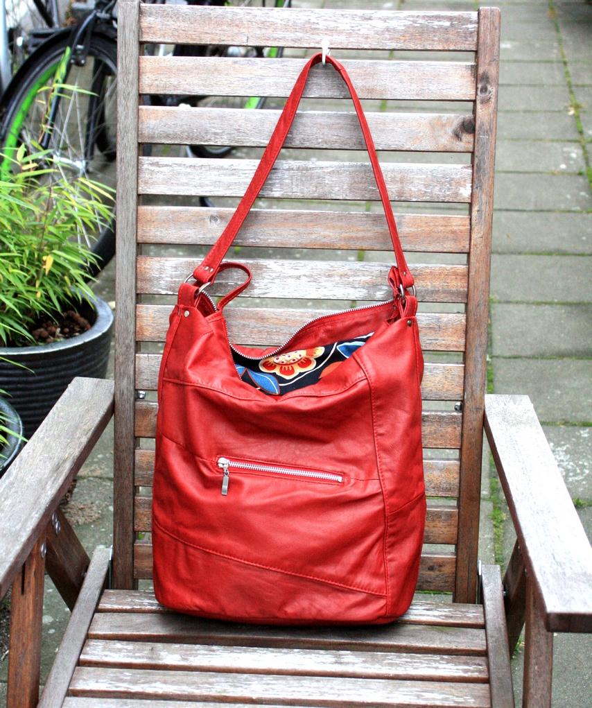 A red shoulder bag