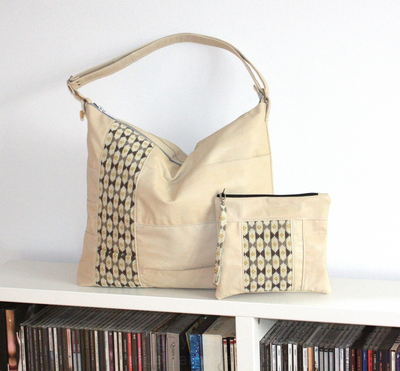 A beige leather bag with embroidery