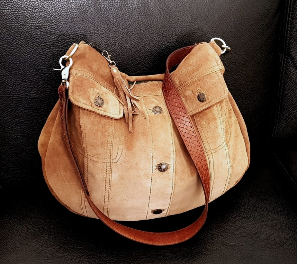 The brown suede jacket bag