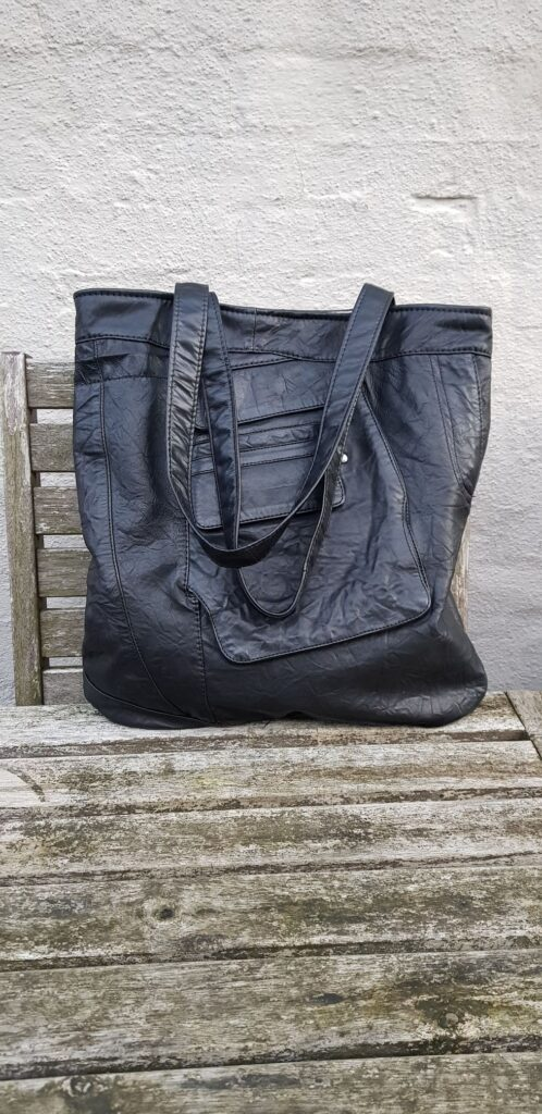 Black shopper from small trousers